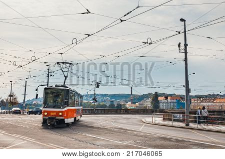 Prague Czech Republic October 01 2017: Red tram goes on old town in Prague. Prague's major public transport operator is The Capital City of Prague Transport Company Czech Republic