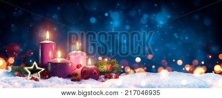 Advent Candles In Christmas Wreath - Three Purple And One Pink As A Religious Symbol