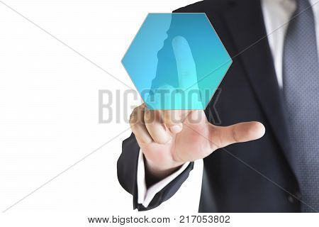 businessman in dark gray suit making decision in business by pushing on one hexagonal button. Businessman hand pushing digital screen