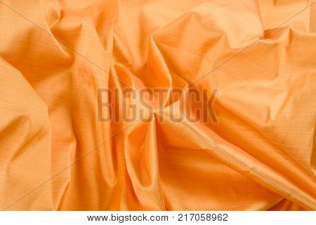 Abstract background luxury silk yellow fabric, drapery, texture, background, pattern