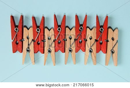 Set of colored pegs for clothes.Backgrounds, Textures, Clean & Wash, Housework Concept. Colorful  Background With Wooden Objects,A Lot Of Copy Space. Studio Shot of a Wooden Peg.Colored Clothespegs.