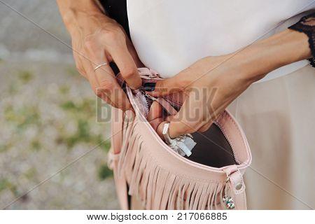 Beautiful woman, has leather handbag. Close up