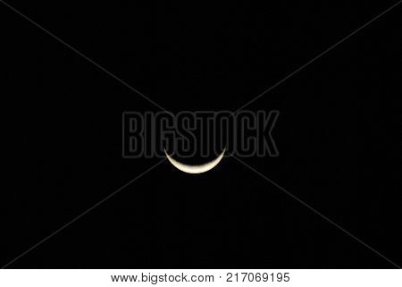 A sliver of the shining moon creates a great background of a smiling face