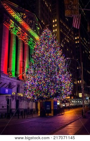 NEW YORK-DECEMBER 05: The colorful lights of the Wall St Christmas tree as seen before dawn on December 5 2017 in lower Manhattan.