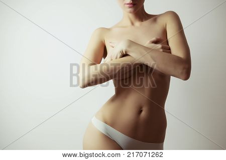 woman perfect figure - liposuction and fat loss concept white background