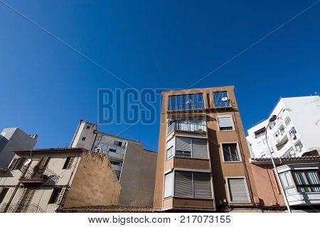 MALLORCA, BALEARIC ISLANDS, SPAIN - NOVEMBER 8, 2017: Building details in Santa Catalina on a sunny day in Palma de Mallorca on November 8, 2017 in Mallorca, Balearic islands, Spain.