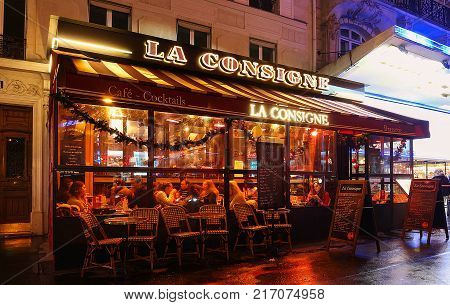 Paris, France -December 03, 2017: Typical Parisian cafe La Consigne decorated for Christmas in the heart of Paris. Christmas is one of the main Catholic holidays, which is celebrated on a large scale throughout