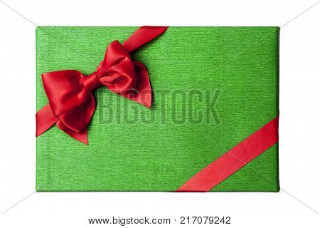 Christmas gift box lid top view. Green wrapping paper box with red satin ribbon and bow. White background isolated