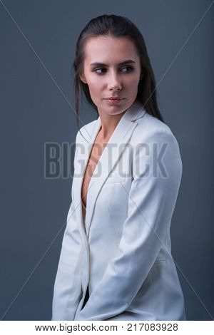 Dark secret. Intelligent good looking budding woman looking aside hiding a secret and waiting for a man