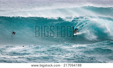 SUNSET BEACH HAWAII USA - DECEMBER 2, 2017: Competitive surfer and photographer at the 2017 Vans World Cup of Surfing competition at Sunset Beach on Oahu's scenic North Shore. This is the second of three surfing competitions and Conner Coffin