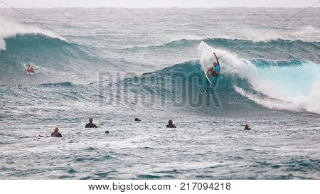 SUNSET BEACH HAWAII USA - DECEMBER 2: Competitive surfers at the 2017 Vans World Cup of Surfing competition at Sunset Beach on Oahu's scenic North Shore. This is the second of three surfing competitions and Conner Coffin