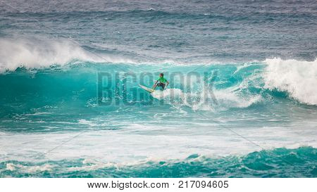SUNSET BEACH HAWAII USA - DECEMBER 2, 2017: Competitive surfer at the 2017 Vans World Cup of Surfing competition at Sunset Beach on Oahu's scenic North Shore. This is the second of three surfing competitions and Conner Coffin took first place.