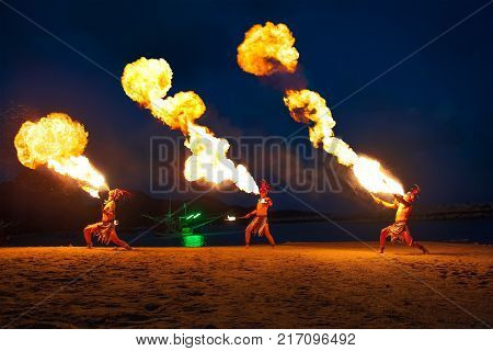 Kho Samui, TH. - March 3, 2017 : FIRE BREATHERS ON SHOW. Fire shows on the beach are a common form of night-time entertainment for visitors at Kho Samui, Thailand.