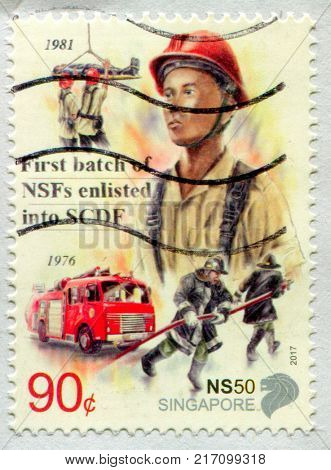 GOMEL, BELARUS, 3 DECEMBER 2017, Stamp printed in Singapore shows image of the First batch of NSFs enlisted into SCDF, circa 1976.