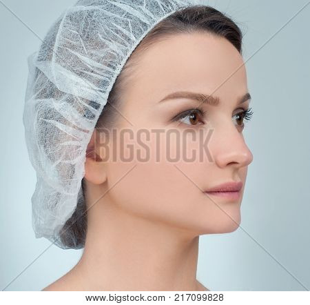 Portrait of female face before plastic surgery. Rhinoplasty. Anti-aging treatment and face lift.