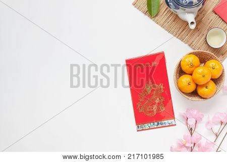 Flat lay image of accessories Chinese new year and Lunar new year festival concept background.Mix variety object for the season.Beautiful difference items on modern rustic wood at home office desk.