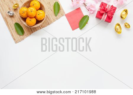 Flat lay of accessories Chinese new year and decorations Lunar new year festival concept background.copy space for mock up & template.Difference items on modern white wooden at home office desk.