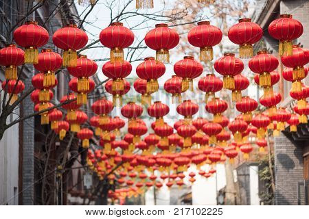 Red chinese lanterns hanging in a street for the chinese new year festival in China