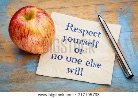 Respect yourself or no one else will - handwriting on a napkin with a fresh apple