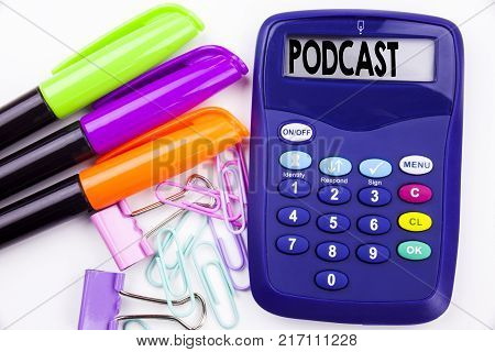 Writing word Podcast text in the office with surroundings such as marker, pen writing on calculator. Business concept for Internet Broadcasting Concept white background with space