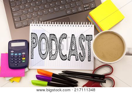 Word writing Podcast in the office with laptop, marker, pen, stationery, coffee. Business concept for Internet Broadcasting Concept Workshop white background with space