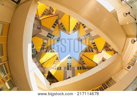 Rotterdam, The Netherlands - October 23, 2011: Low angle fisheye view of yellow Cubic Houses or Kubuswoningen designed by architect Piet Blom in 1977.