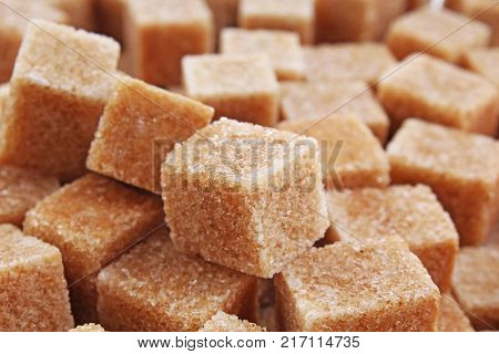 Granulated brown sugar. Lump sugar. Brown sugar cubes. Cane sugar. Sweets