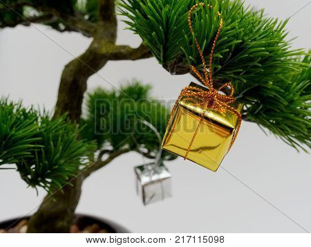 Christmas Decoration Or Ornament Hang On Artificial Bonsai Tree Composed Of Gold And Silver Gift Box