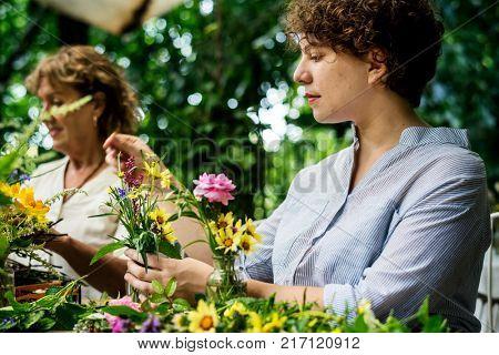 Women arranging flowers
