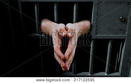 Jail Cell Door And Hands
