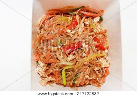 Vegetable Noodles Stir-Fry Asian Traditional Cuisine: Pasta Food Close Up. Rice Stir Fry Noodles Dish in Take Out Paper Box Healthy Nutritious Meal. Fast Cooked Food in Delivery Box Isolated on White