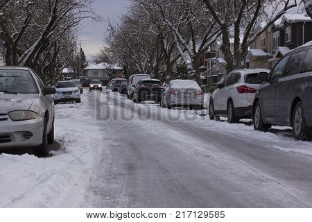Side streets were sheets of ice throughout most of the winter of 2016 in Vancouver, BC, Canada. Here a vehicle proceeds cautiously north bound on Argyle St. at 33rd Avenue.