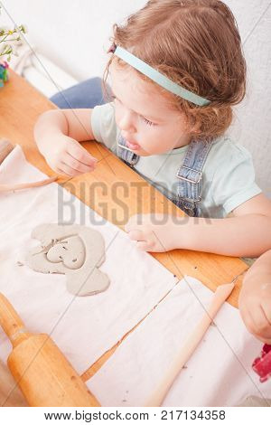 Cute children sculpt with natural clay. Natural tactile and play lesson