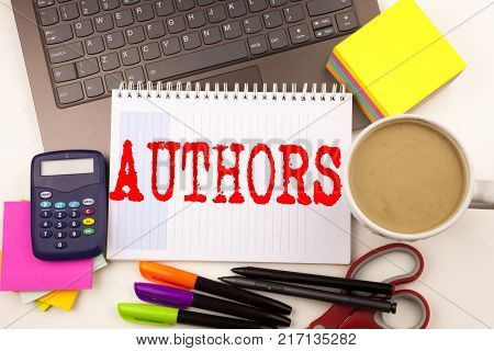 Word writing Authors in the office with  laptop, marker, pen, stationery, coffee. Business concept for Word Message Text Typography Workshop white background with space