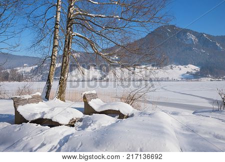Loisach River In Winter With View To Ski Flying Hill