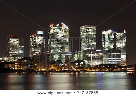 London, UK, October 20, 2011: Canary Wharf in London's Docklands at the Isle of Dogs on the River Thames at night  showing its illuminated skyscrapers