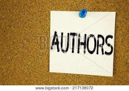 Conceptual hand writing text caption inspiration showing Authors. Business concept for  Word Message Text Typography written on sticky note, reminder cork background with space