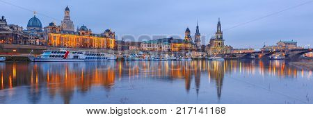 Dresden Cathedral of the Holy Trinity or Hofkirche, Bruehl's Terrace or The Balcony of Europe, Semperoper and Augustus Bridge with reflections in the river Elbe in Dresden, Saxony, Germany