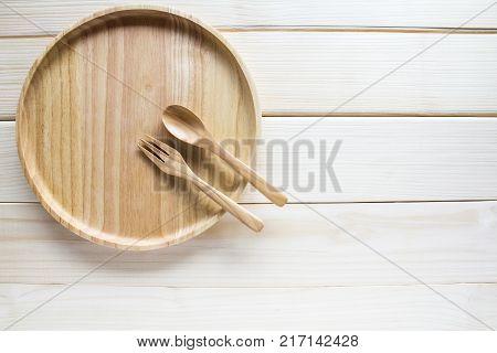 Top view Wooden kitchen utensils on wooden background