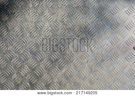 texture of stainless steel floor plate, note  select focus with shallow depth of field
