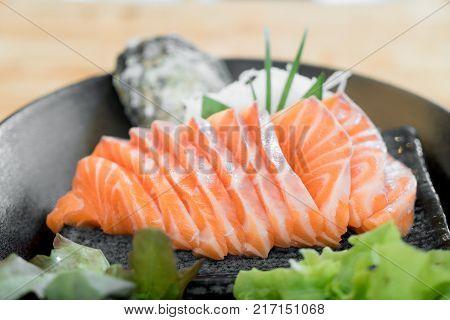 Japan raw salmon slice or salmon sashimi in Japanese style fresh serve on ice in Japanese restaurant.
