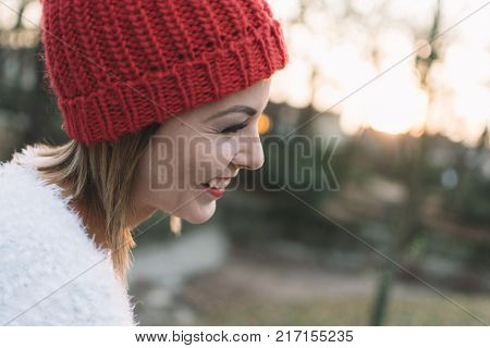 Carefree girl enjoy life outdoor. Happy life concept. Smiling woman at sunset. Beautiful woman portrait.