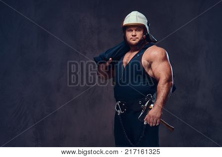 Brutal firefighter dressed in underwear waistcoat and white firefighter helmet.