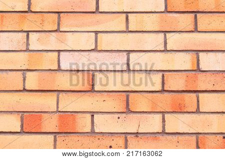 Stone texture background of red brick wall, texture of stone bricks. Closeup of stone texture wall, made of stone bricks, texture stone background. Stone background, texture of stone brick wall