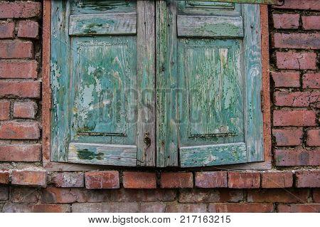 Close up obsolete cyan wooden window shutters