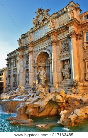 The Fontana di Trevi (Trevi Fountain) shown at sunset light Rome Italy. The Trevi Fountain was finished in 1762 by Giuseppe Pannini
