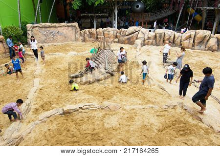 Blurred Image - Children's Discovery Museum, Bangkok Thailand :January 12, 2018:- Children learning about, Excavating dinosaur fossils simulation in the Discovery Museum