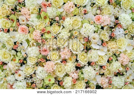 Beautiful artificial flowers background for wedding scene free space. Floral background copy space view from above. Holiday greeting card for Valentine's Day Woman's Day (March 8) Mother's Day