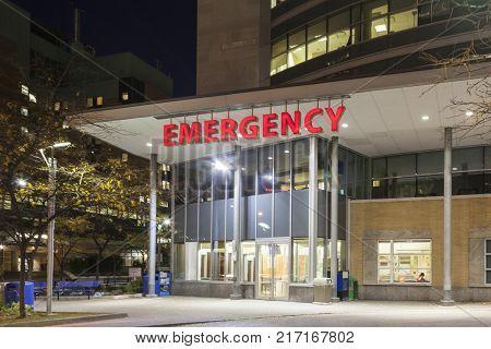 Emergency entrance at a modern hospital illuminated at night