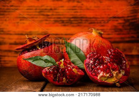 Juicy Pomegranate On Wooden Boards.cut Into Pieces Of Ripe Pomegranate. The Pomegranate Is Ripe. Rip